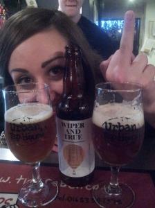 2 Glasses, 1 bottle, 1 West Walian bar pixie, 1 mystery finger.