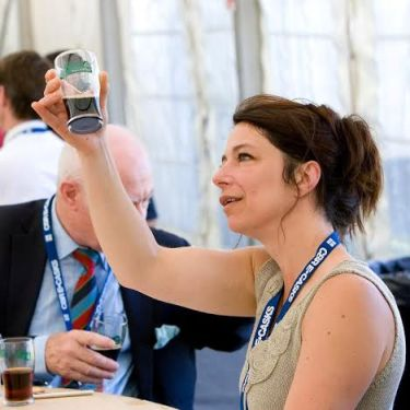 Sue in action judging beer (Photo attributed to Sue Hayward)