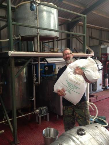 Ian with the first ever bag of malt used at the brewery (Photo attributed to Ian Bowler)