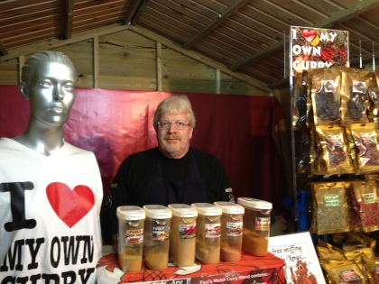 Paul selling curry powder at the Christmas market